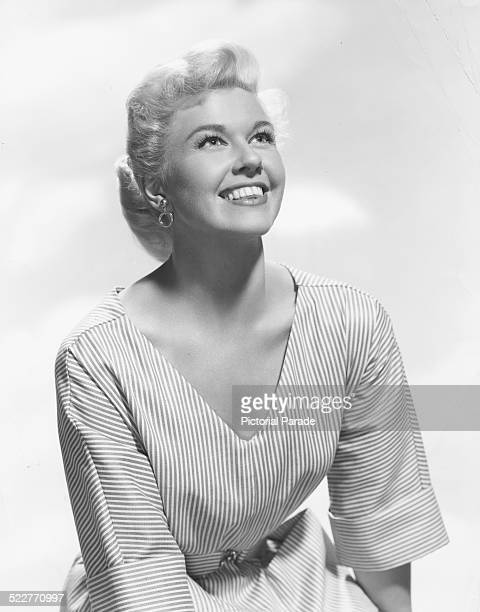 Portrait of singer and actress Doris Day wearing a striped dress circa 1955