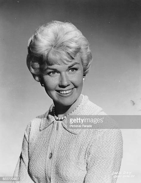 Portrait of singer and actress Doris Day wearing a sweater and a string of pearls circa 1955