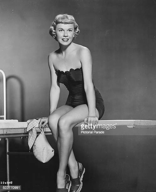 Portrait of singer and actress Doris Day wearing a swimsuit and sandals as she appears in the movie 'The Winning Team' 1952
