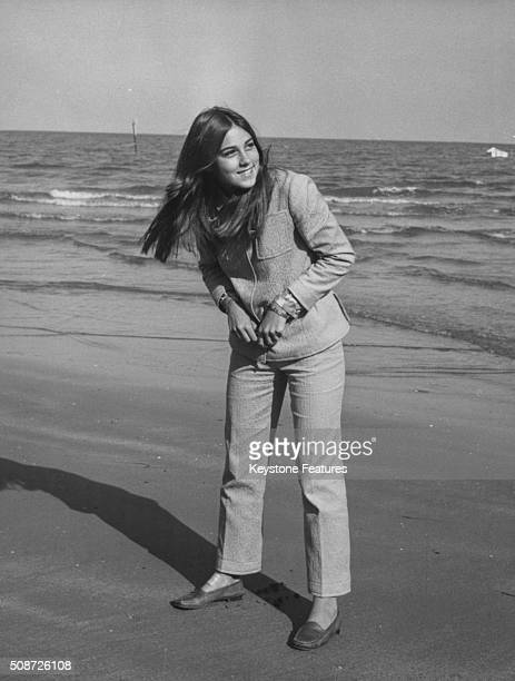 Portrait of singer and actress Romina Power daughter of famous actor Tyrone Power standing on a beach circa 1970