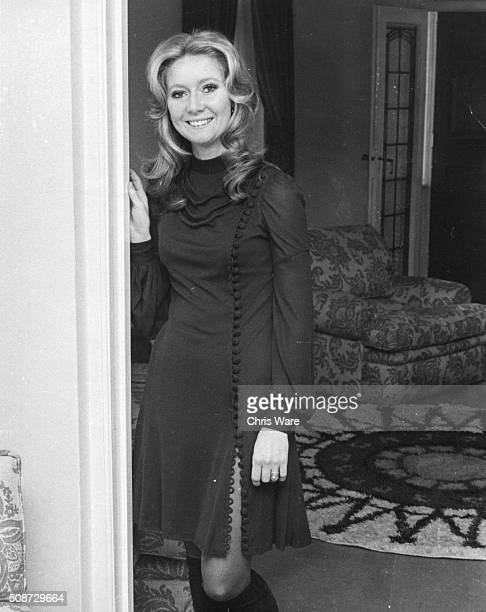 Portrait of singer Clodagh Rodgers who will soon be representing Great Britain in the Eurovision Song Contest standing in the doorway of a sitting...