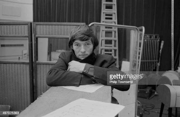 Portrait of singer Dave Berry at a band rehearsal 1964