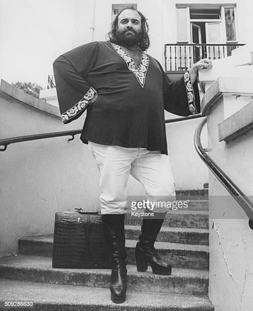 Portrait of singer Demis Roussos standing on a staircase in London July 9th 1976