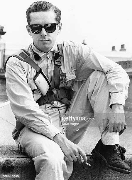 Portrait of singer Holly Johnson of the band 'Frankie Goes to Hollywood' wearing overalls and sunglasses June 20th 1984