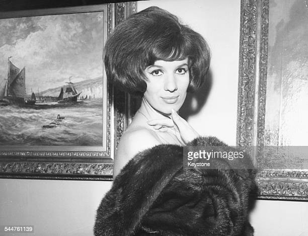 Portrait of singer Iva Zanicchi wearing a fur coat circa 1965