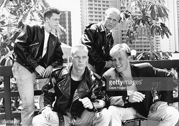 Portrait of singer Jason Donovan with British boy band 'Bros' Craig Logan Matt Goss and Luke Goss in Australia November 1st 1988