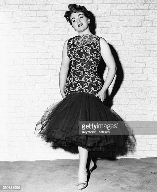 Portrait of singer Marion Ryan wearing a dress with a fishtail skirt, circa 1950.