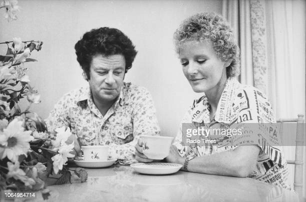 Portrait of singer Petula Clark and her husband film producer Claude Wolff drinking at their kitchen table photographed for Radio Times in connection...
