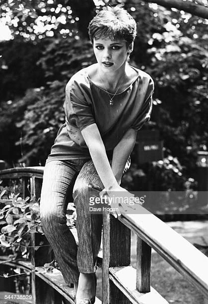 Portrait of singer Sheena Easton sitting on a bridge July 15th 1982