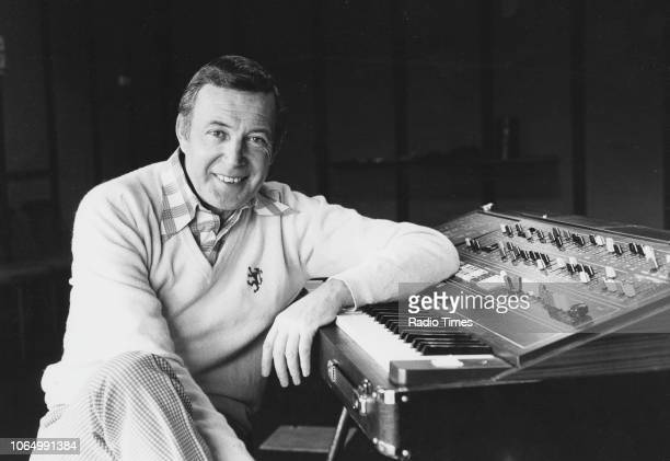 Portrait of singer Val Doonican sitting at a keyboard March 25th 1978