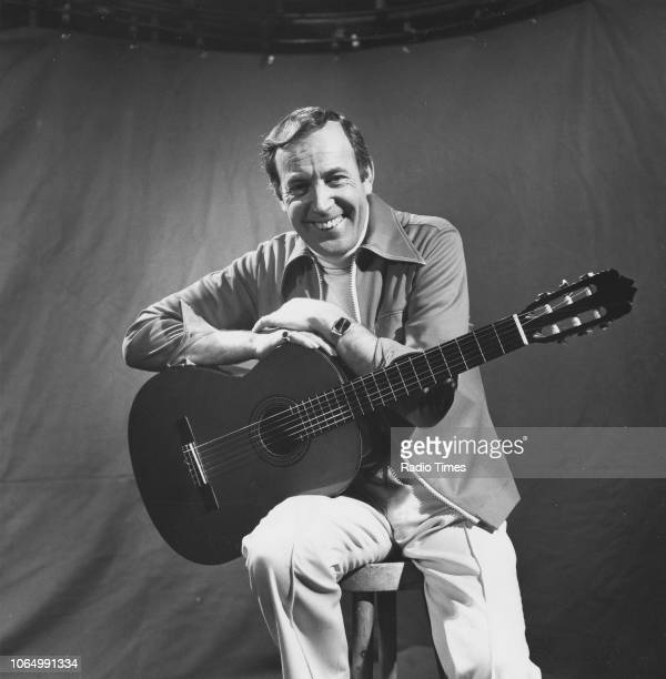Portrait of singer Val Doonican with his guitar March 17th 1977