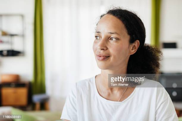 portrait of single mom relaxing at home - women stock pictures, royalty-free photos & images