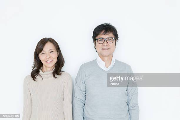 portrait of sinior man and mature woman - asian 50 to 55 years old woman stock photos and pictures