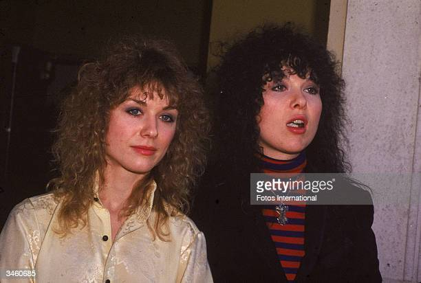 Portrait of sisters Nancy and Ann Wilson of the rock band Heart standing outdoors circa 1980s