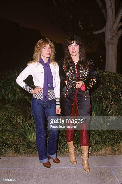 Portrait of sisters Nancy and Ann Wilson of the rock group Heart standing outdoors circa 1980s