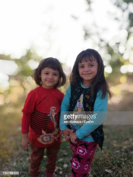 portrait of sisters standing on field - anatolia stock pictures, royalty-free photos & images