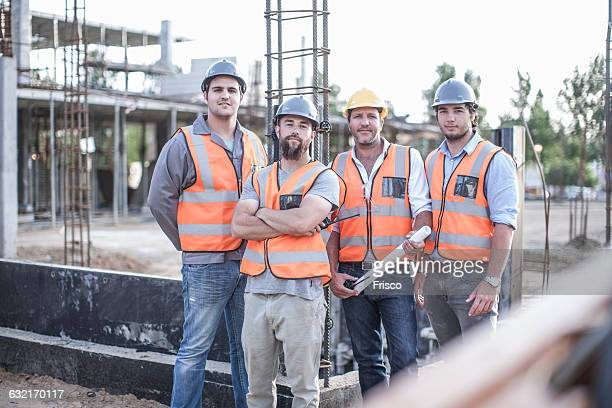 Portrait of site manager and building team on construction site