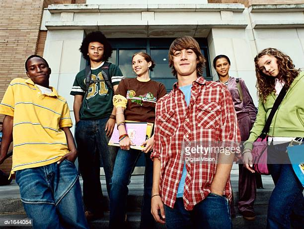 portrait of six cool looking young friends stood together - teenagers only stock pictures, royalty-free photos & images