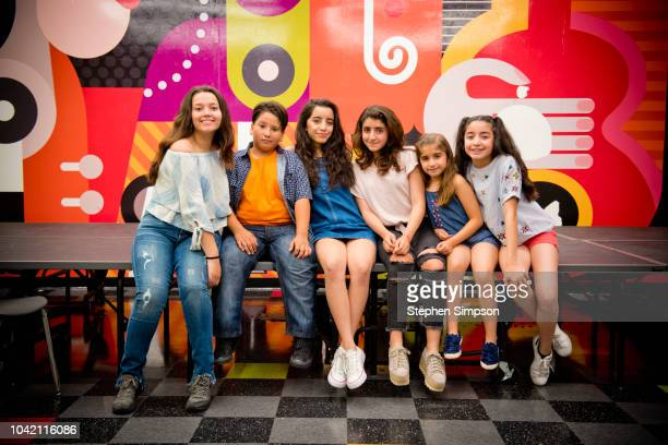 portrait of six teenagers in front of mural - teenagers only stock pictures, royalty-free photos & images