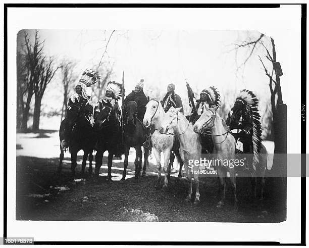 Portrait of six tribal leaders from left Little Plume Buckskin Charley Geronimo Quanah Parker Hollow Horn Bear and American Horse as they pose on...