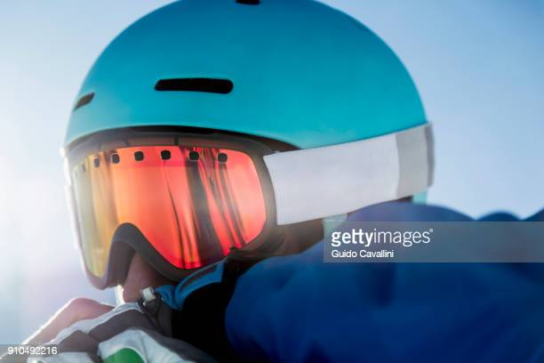 Portrait of skier, wearing ski goggles, close-up