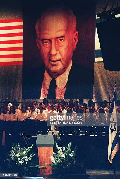 A portrait of slain Israeli Prime Minister Yitzhak Rabin is displayed as his widow Leah Rabin addresses a peace rally and memorial service for Prime...
