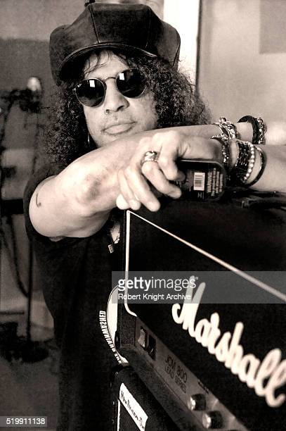Portrait of Slash in his home recording studio leaning on a Marshall amplifier Los Angeles California 19th January 2012