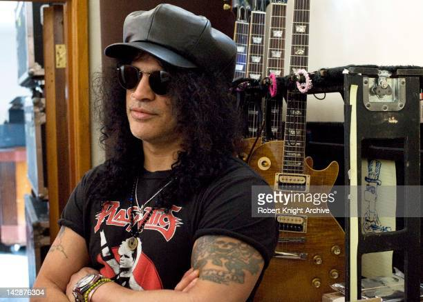 A portrait of Slash with some of his Gibson Les Paul Standard guitars in his home recording studio Los Angeles California 19th January 2012
