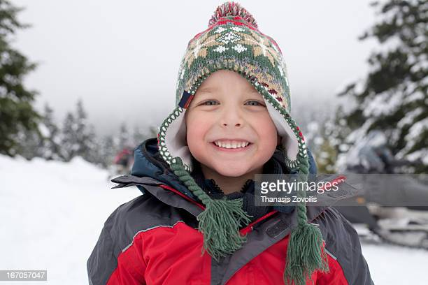 Portrait of small boy on snow winter land