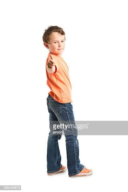 portrait of small boy showing ok