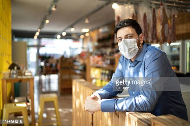 portrait of small business man owner with face mask - face mask protective workwear stock pictures, royalty-free photos & images