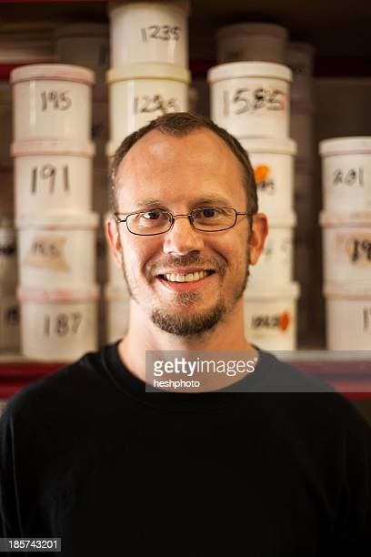 portrait of small business manager in warehouse - heshphoto stock pictures, royalty-free photos & images