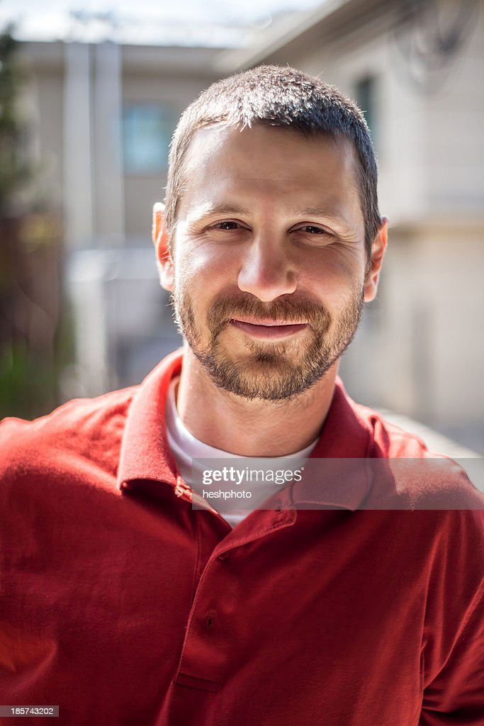 Portrait of small business manager outside warehouse : Stock Photo