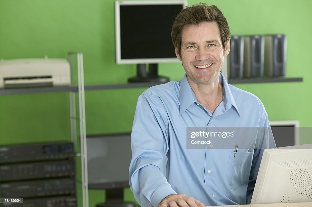 Portrait of small business owner at computer : Stockfoto