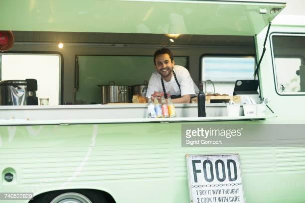 portrait of small business owner at van food stall hatch - sigrid gombert fotografías e imágenes de stock
