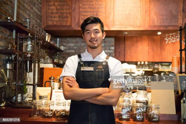 Portrait of small business owner in cafe