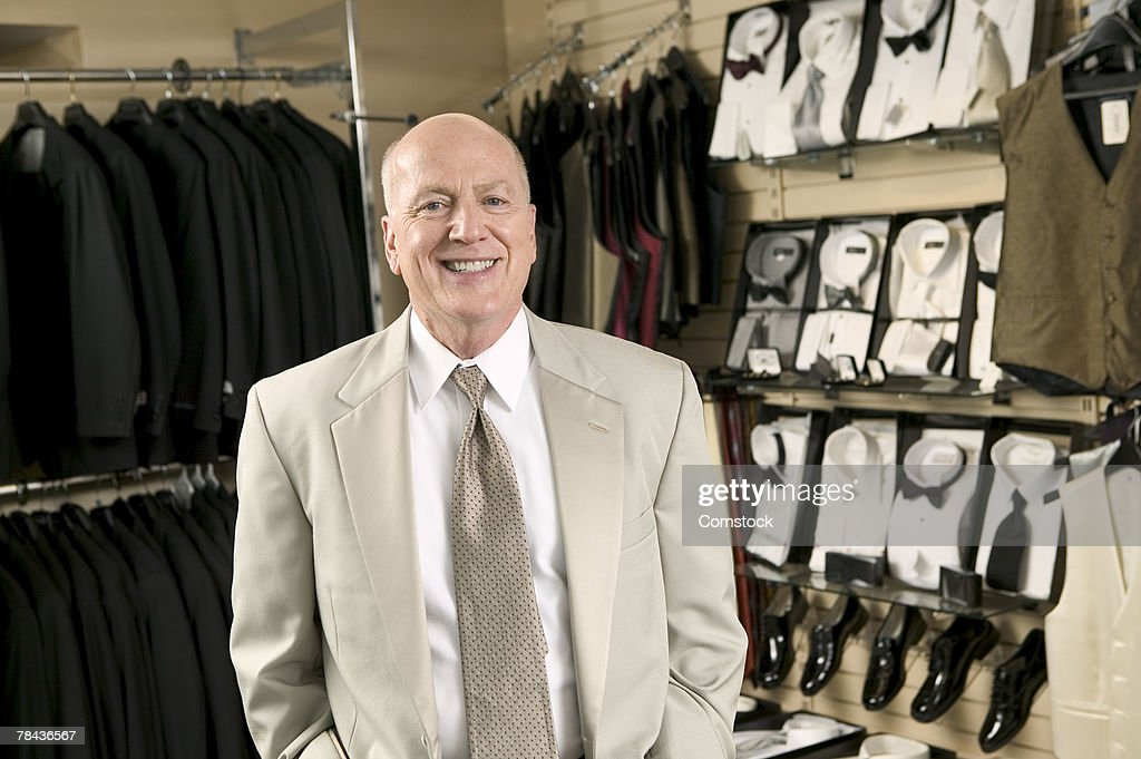 Portrait of small business owner in clothing store : Stockfoto