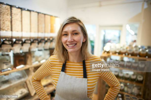 portrait of small business owner in zero waste store, close up. - health food shop stock pictures, royalty-free photos & images