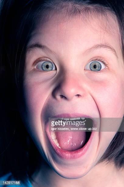 Portrait of small girl scream