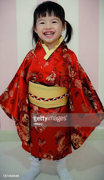 Portrait of small girl wearing Japanese costume