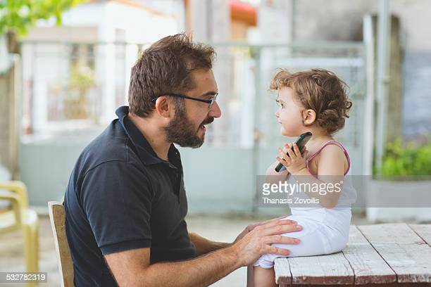 Portrait of small girl with her father