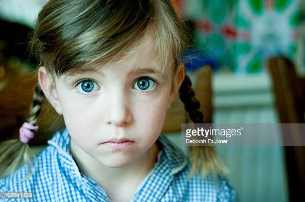 portrait of small, serious girl - sadgirl stock pictures, royalty-free photos & images