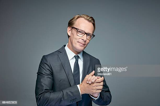 Portrait of smart businessman rubbing his hands