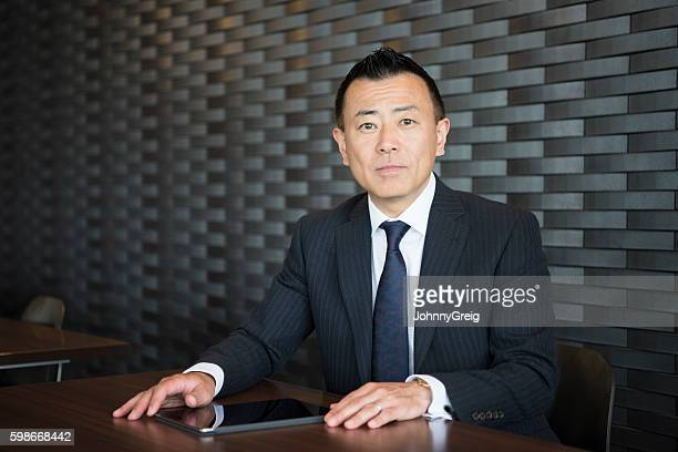 Portrait of smart mature Japanese businessman