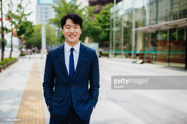 portrait of smart south korean businessman in suit - korean culture stock pictures, royalty-free photos & images