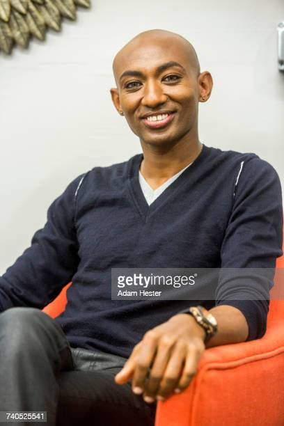 portrait of smiling african american man - non binary gender stock pictures, royalty-free photos & images