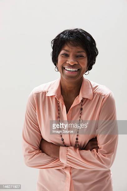 Portrait of smiling African American mature woman, studio shot