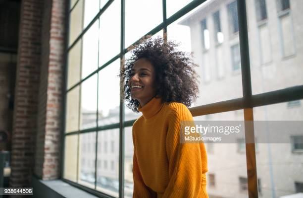 portrait of smiling african american woman - afro stock photos and pictures
