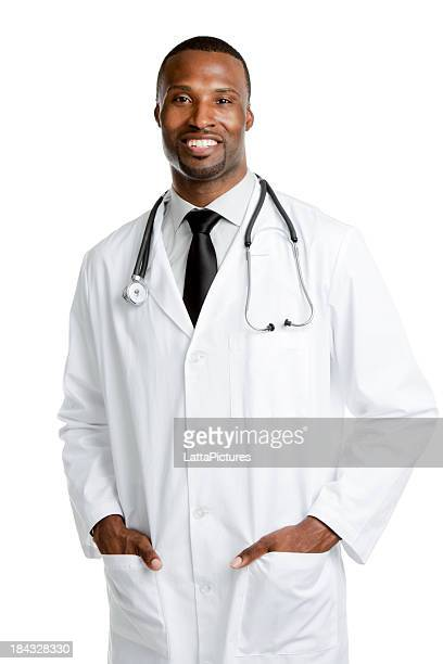 Portrait of smiling African ethnicity male doctor hands in pockets