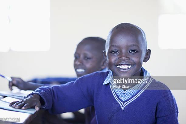 portrait of smiling african schoolboy (10-12) - hugh sitton stock pictures, royalty-free photos & images